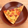 Tasty Italian pizza on plate — 图库照片 #6785536