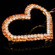 Precious heart-shaped pendant on black background — Stockfoto