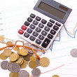 Royalty-Free Stock Photo: Calculator and coins on chart background. (Ukraininan coins)