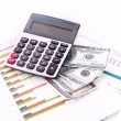 Stock Photo: Calculator and dollars on chart background