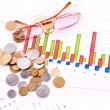 Coins, glasses and charts (Ukraininan coins) — Stock Photo