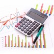 Stock Photo: Coins, pen, calculator and charts