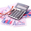 Calculator and charts - Stock Photo