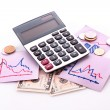 Calculator, notes, coins and dollar banknotes — Stock Photo