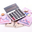Stock Photo: Calculator, notes, coins and dollar banknotes