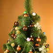 Christmas tree with glass yellow balls - Stockfoto