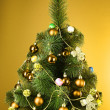 Christmas tree with glass yellow balls — Stock Photo