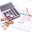 Calculator and some financial charts (Ukraininan coins) — Stock Photo #6786420
