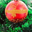 Stock Photo: Red Christmas balls among green new year tree