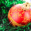Royalty-Free Stock Photo: Red Christmas balls  among green new year tree