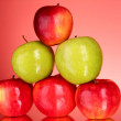 Apples on red background — Stock Photo