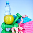 Blue bottle of water, apple, sports towel, measure tape and dumb — Stock Photo #6786792