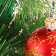 Red Christmas balls among green new year tree — Stock Photo #6786826