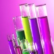 Test tubes on pink background - Foto Stock