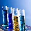 Test tubes on blue background - Foto Stock