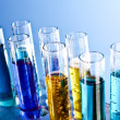 Test tubes on blue background — Stock Photo