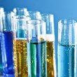 Test tubes on blue background - Lizenzfreies Foto