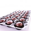 Stock Photo: Chocolates in box