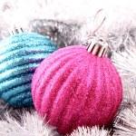 Christmas balls in shiny decoration — Stock Photo