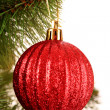 Stock Photo: Christmas balls hanging with ribbons on fir tree