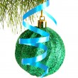 Christmas ball hanging with ribbons on fir tree - Zdjęcie stockowe