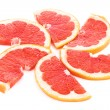 Slices of grapefruit in the form of circle isolated on white — 图库照片