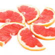 Slices of grapefruit in the form of circle isolated on white — ストック写真