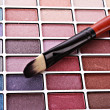 Brush and eye shadows — Stock Photo