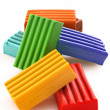 Stock Photo: Childen bright coloured plasticine set chaotically isolated on w