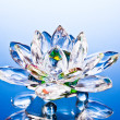 Glass lotus flower on blue — Stock Photo