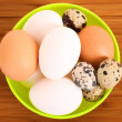Stock Photo: Group of brown and white hen's and quail spotted eggs in pla