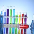 Test tubes on blue background - Stockfoto