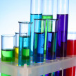 Test tubes on blue background — Stock Photo #6788846