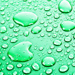 Stock Photo: Green water drops background
