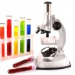 Laboratory metal microscope and test tubes with liquid isolated — Stock Photo #6789799