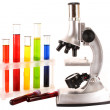 Laboratory metal microscope and test tubes with liquid isolated — Stock Photo #6789814