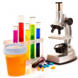 Laboratory metal microscope and test tubes with liquid isolated — Stock Photo #6789846