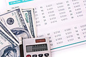 Some financial things - calculator, money, digits, charts — Stock Photo