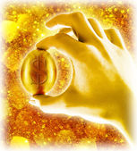 Gold egg in hand on golden background — Stock Photo