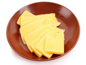Cheese on plate isolated on white — Stock Photo
