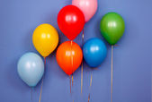 Flying balloons on blue background — Stock Photo