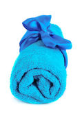 Twisted blue towel with band isolated on white — Stock Photo