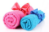 Twisted blue and pink towels with bands isolated on white — Stock Photo