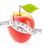 Apple with green leaf and a measure tape, diet concept — Stock Photo