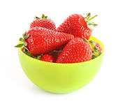 Few strawberries in green cup isolated on white — Stock Photo