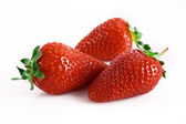 Three stawberries isolated on white — Stock Photo