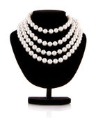 Pearl necklace on support isolated on white — Stok fotoğraf