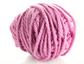 Pink ball of woollen red thread isolated on white — Stock Photo