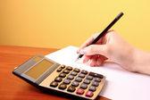 Escrita e calculadora — Foto Stock