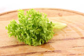 Green salad leaves on wooden surface — 图库照片
